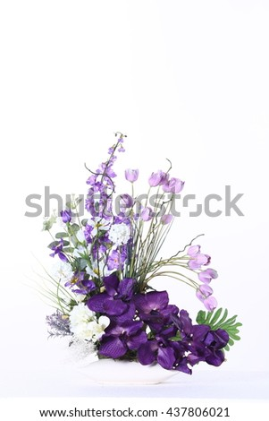 Assorted Artificial Flower Bouquet in Purple Color and kind of flowers in Studio Lighting on White Background