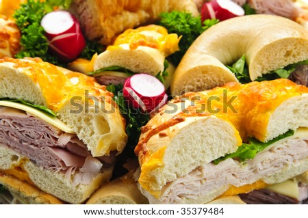 Assorted bagel sandwich platter with meat and vegetables - stock photo