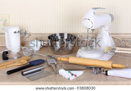 Assorted baking utensils on a kitchen counter - stock photo