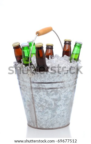 Assorted beer bottles in a bucket of ice isolated on a white background. Vertical format with reflection. - stock photo