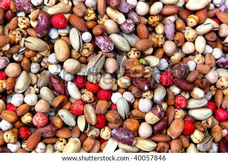 Assorted beer nuts as background - stock photo