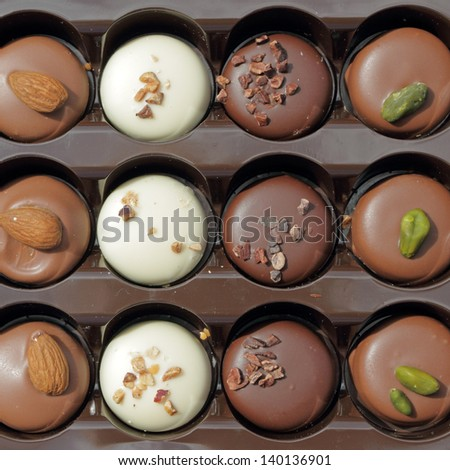 assorted belgian chocolate pralines in box as background - stock photo