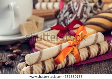 Assorted biscuits and sweets on table - stock photo