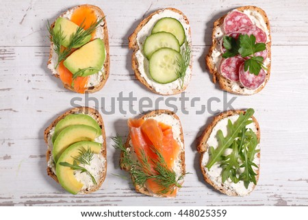 assorted bread with vegetable - stock photo