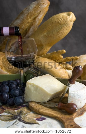 Assorted Breads and cheese and a glass of Chianti Wine - stock photo