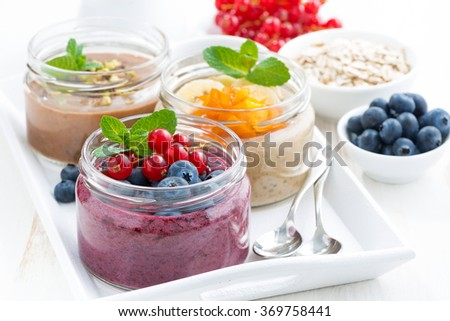assorted breakfast of chia seeds and fruits in jars, closeup