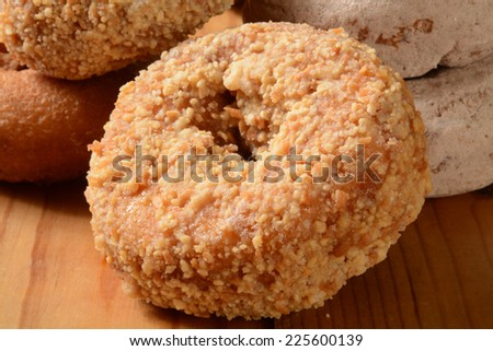 Assorted cake donuts on a rustic wooden counter