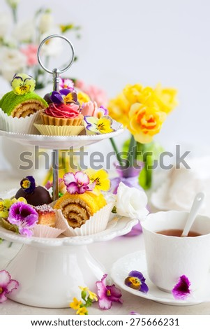 Assorted cakes and pastries on a cake stand for afternoon tea - stock photo