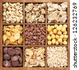 Assorted cereals in wooden box - stock photo