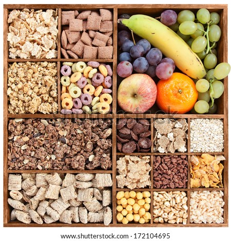 assorted cereals in wooden box with fresh fruits (manual focus) - stock photo