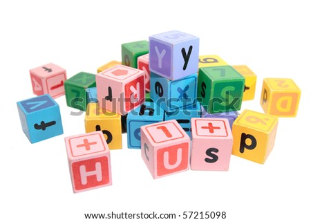 assorted children toy letter building blocks against a white background - stock photo