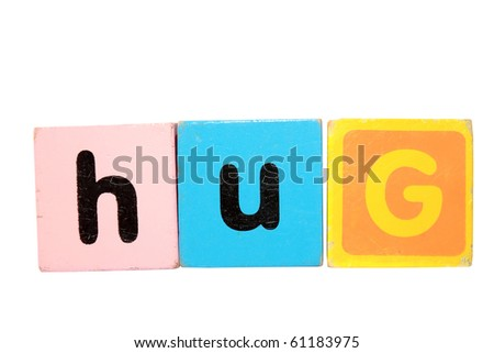 assorted children toy letter building blocks against a white background that spell hug with clipping path - stock photo