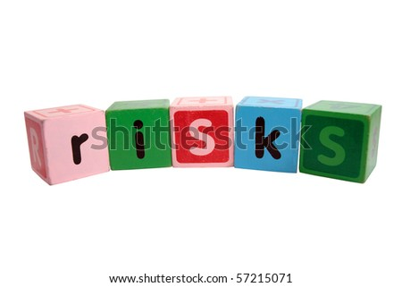 assorted children toy letter building blocks against a white background that spell risks - stock photo