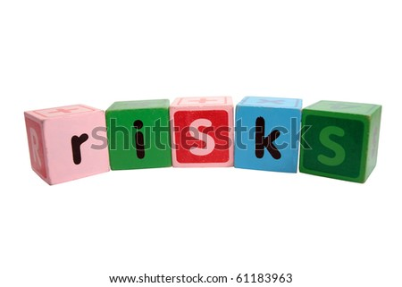 assorted children toy letter building blocks against a white background that spell risks with clipping path - stock photo
