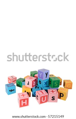 assorted children toy letter building blocks against a white background with copy space - stock photo