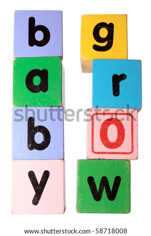 assorted childrens toy letter building blocks against a white background that spell baby grow with clipping path - stock photo