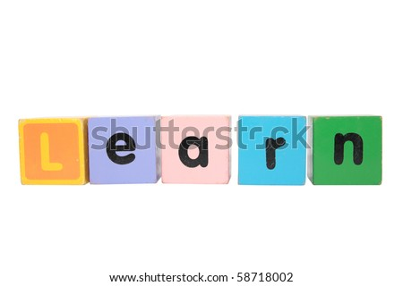 assorted childrens toy letter building blocks against a white background that spell learn with clipping path - stock photo
