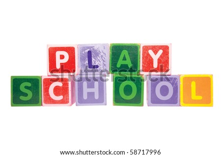 assorted childrens toy letter building blocks against a white background that spell playschool with clipping path - stock photo