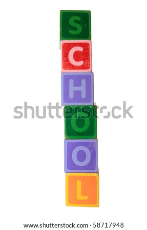 assorted childrens toy letter building blocks against a white background that spell school with clipping path - stock photo