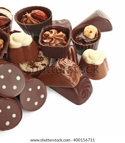 Assorted chocolate candies, isolated on white - stock photo