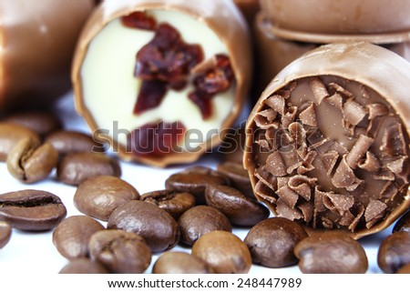 Assorted chocolate confectionery with coffee beans  - stock photo