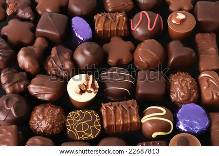Assorted chocolate truffles. - stock photo