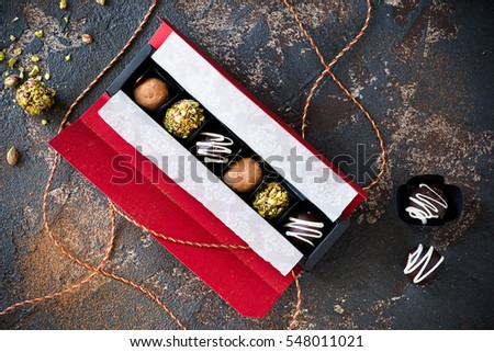 Assorted chocolate truffles in gift box, top view