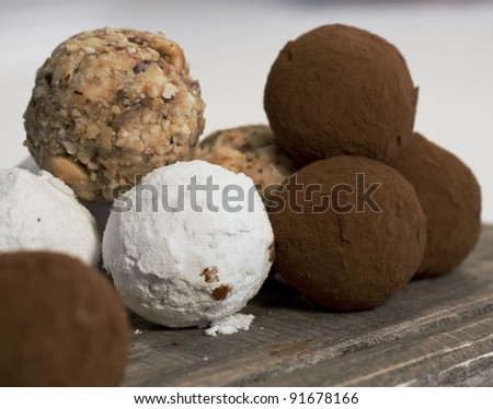 assorted chocolate truffles on a board - stock photo
