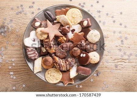 Assorted christmas cakes on the metal plate