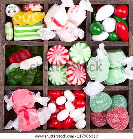Assorted Christmas candy in a printers box - stock photo