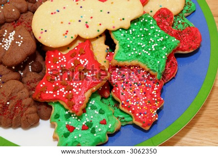 Assorted Christmas cookies piled on a plate. - stock photo