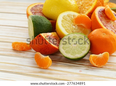 Assorted citrus - lemon, manadarin, orange  and lime - stock photo