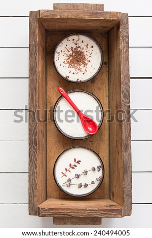 Assorted Coconut Panna Cotta in a Wooden Box - stock photo