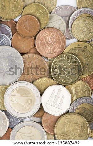 assorted coins from different countries - stock photo