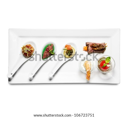 assorted cold appetizers, white background - stock photo