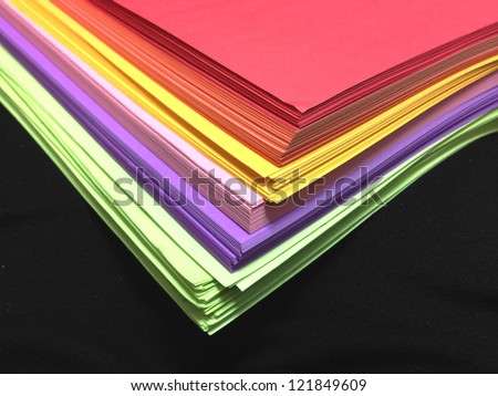 Assorted Colored Pile of Papers on Black Background