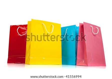 Assorted colored shopping bags including red, yellow, blue and pink on a white background