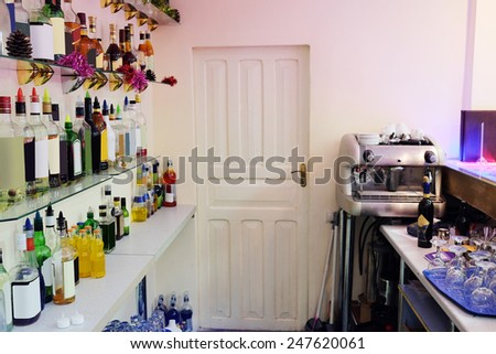 Assorted colorful bottles of alcoholic drinks in a bar  - stock photo