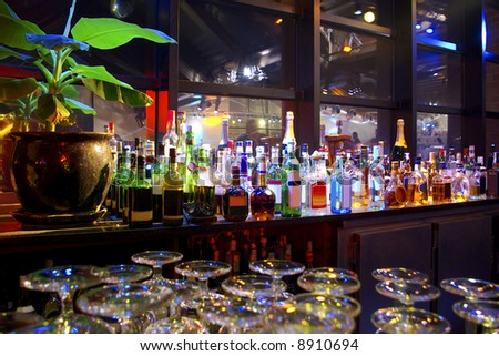 Assorted colorful bottles of alcoholic drinks in a night-club - stock photo