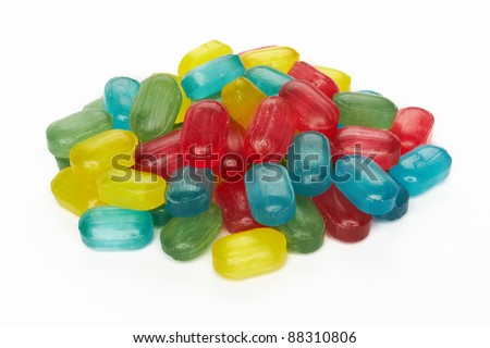 assorted colorful candies on white background