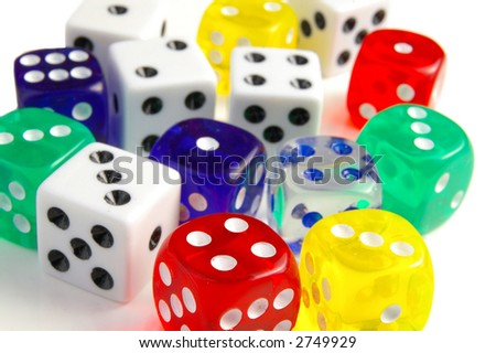 Assorted colorful dice, closeup, foreground is sharp