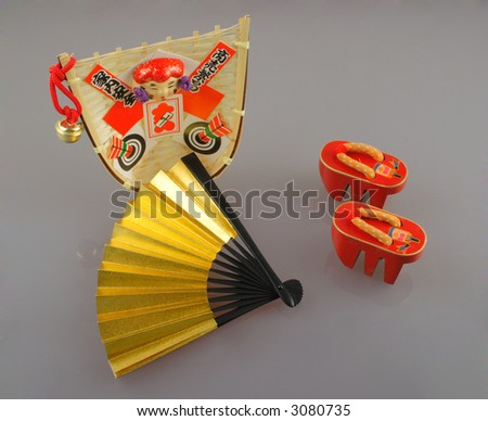 Assorted colorful handmade Japanese style souvenirs  isolated on a solid monotone background  - stock photo