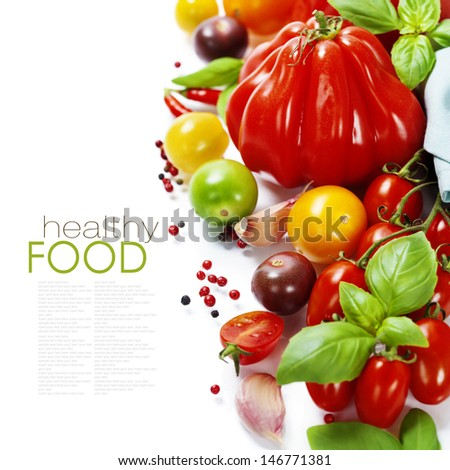 Assorted colorful tomatoes and herbs on white background - healthy eating concept (with easy removable sample text) - stock photo