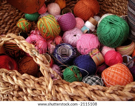 Assorted colorful yarn in a basket.