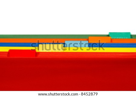 Assorted colors file folders with red in front of yellow and blue with orange and green featuring blank plastic tabs for copy space text over white - stock photo