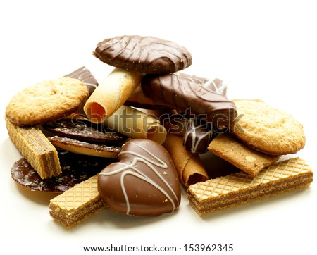 Assorted cookies with chocolate and nuts on  white background - stock photo