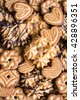 Assorted cookies with cocoa, dark and white chocolate glaze and nuts, selective focus - stock photo