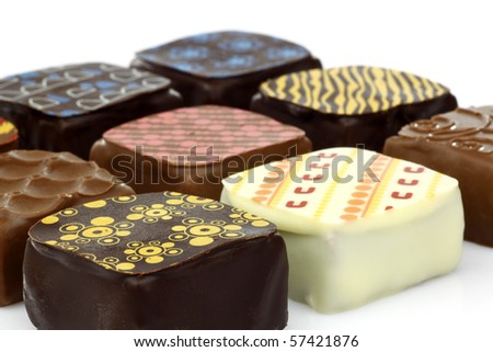 assorted decorated luxury chocolate bonbons on a white background - stock photo