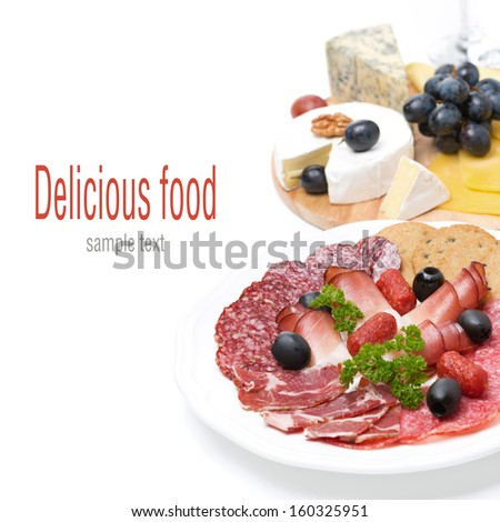 assorted deli meats and a plate of cheese, isolated on white - stock photo