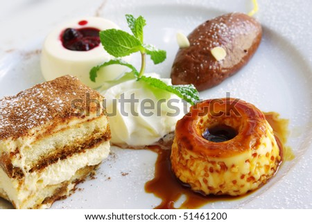 Assorted delicious desserts in a single plate - stock photo